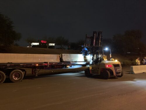 Concrete barrier is installed along the freeway to establish the work zone